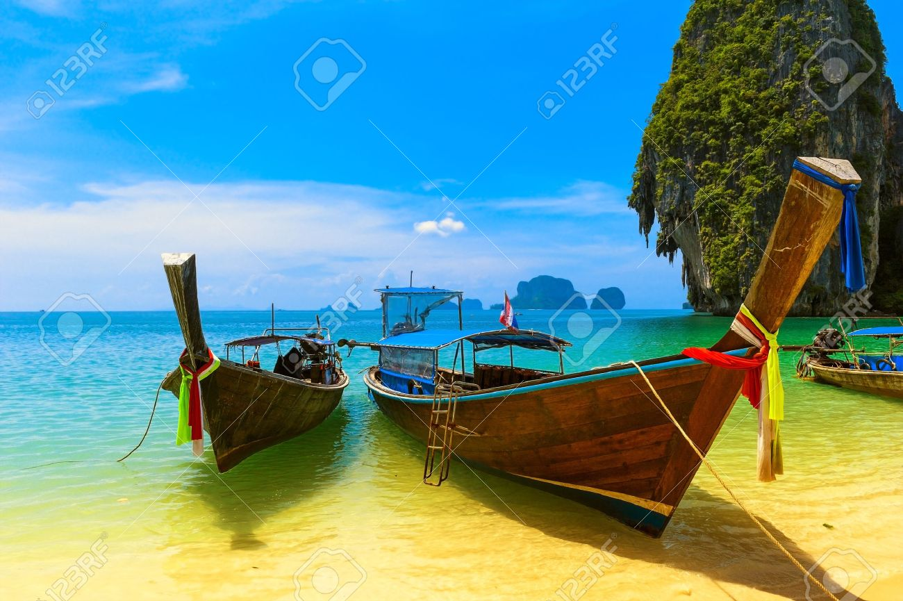 Travel landscape, beach with blue water and sky at summer  Thailand nature beautiful island and traditional wooden boat  Scenery tropical paradise resort Stock Photo - 16006503