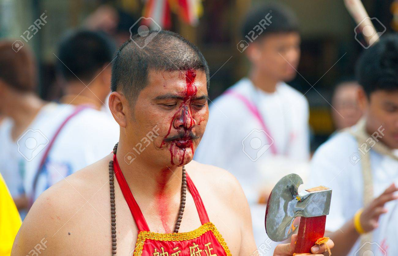 PHUKET, THAILAND- OCT 23: Unidentified participant the parade on October 23, 2012 Vegetarian Festival Phuket Thailand. The Festival is a famous annual festival also known as Nine Emperor Gods festival Stock Photo - 20390388