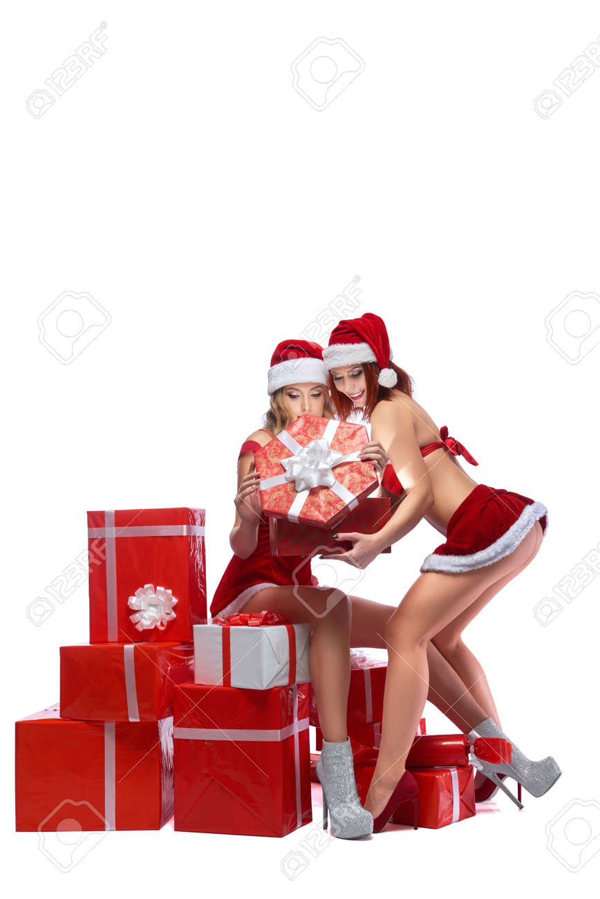 Christmas Presents For Girls.Two Sexy Santa Girls Posing With Christmas Presents
