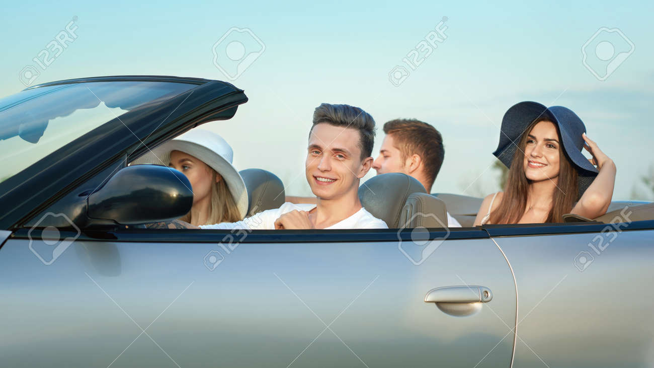 Company Going For Drive In Silver Cabriolet Couples Sitting Stock Photo Picture And Royalty Free Image Image 110690233
