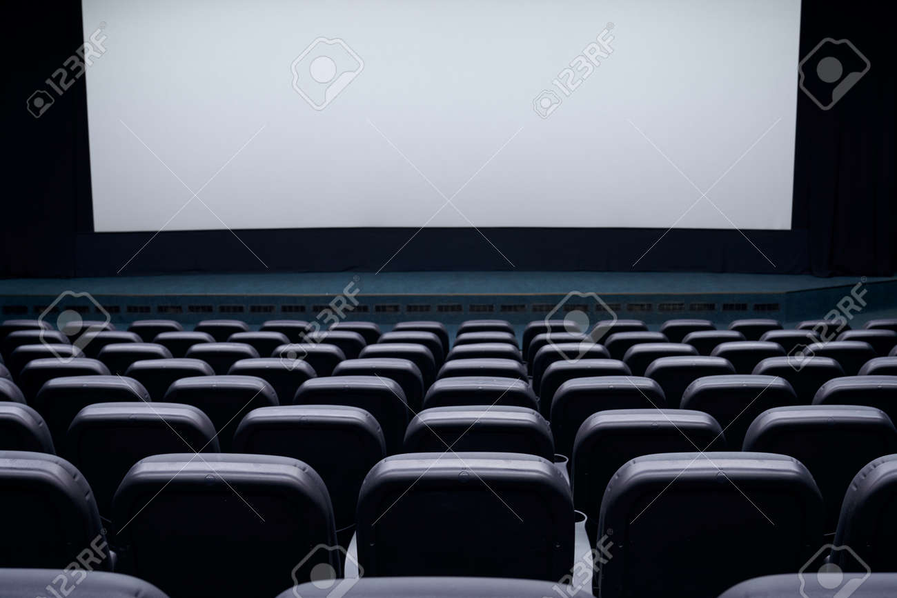 Cinema auditorium with black seats and white blank screen. Concept of interior cinema hall. - 165681855