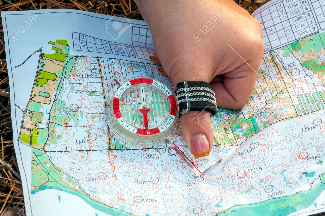 Topographic Map Games.Orienteering Compass And Topographic Map The Athlete Uses