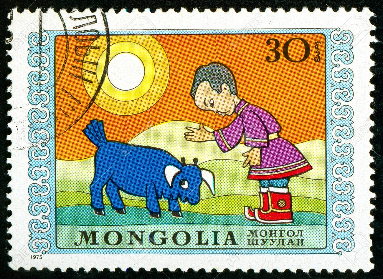 Ukraine - circa 2018: A postage stamp printed in Mongolia show Boy and disobedient bull calf. Series: International Childrens Day. Circa 1975 Banque d'images - 94168096