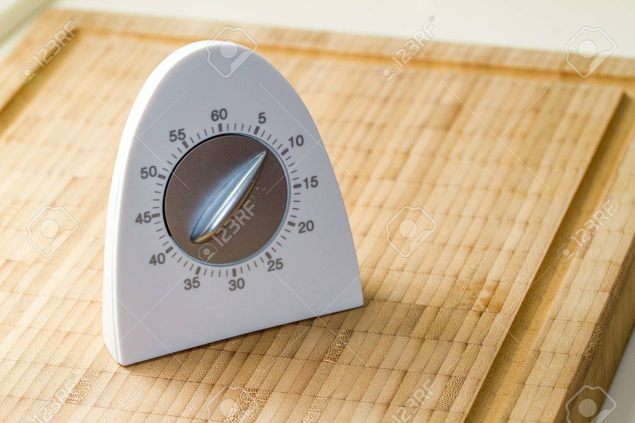 white modern kitchen timer on a wooden cutting board stock photo  - stock photo  white modern kitchen timer on a wooden cutting board