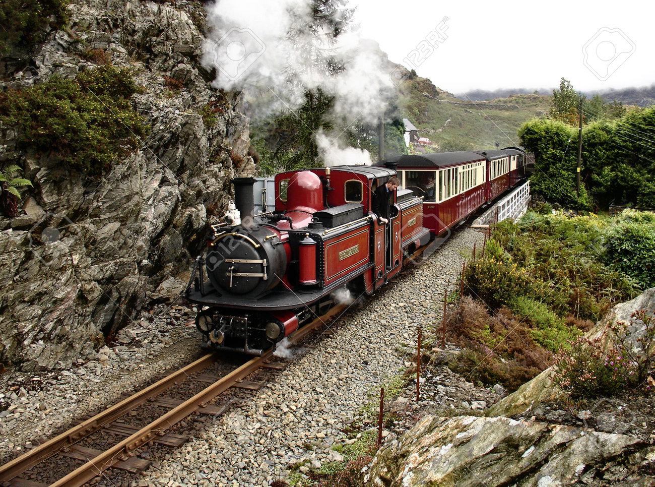 Steam narrow gauge train goes from Blaenau Ffestiniog to Porthmadog