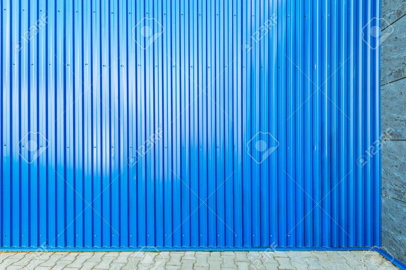 Blue corrugated metal fence background on the floor