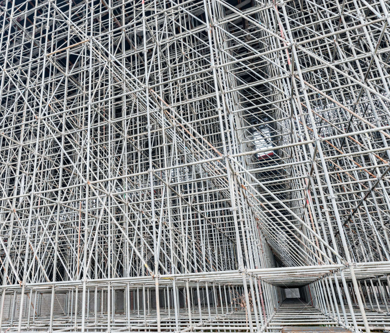 Vertical scaffolding formed a myriad of grid. Industrial and modern urban construction background. - 122283406