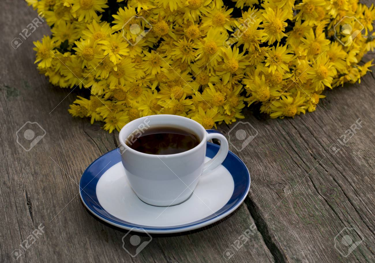 Bouquet Of Beautiful Yellow Flowers And Cup Of Black Coffee Stock