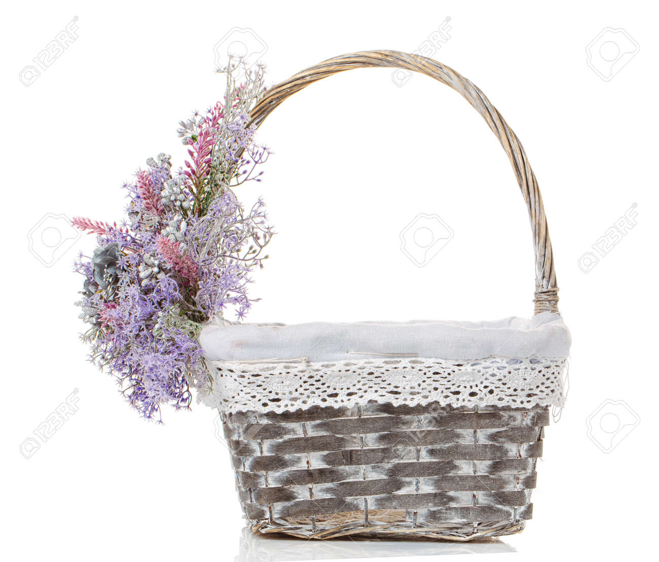 Wicker basket decorated with flowers isolated on white stock photo stock photo wicker basket decorated with flowers isolated on white mightylinksfo