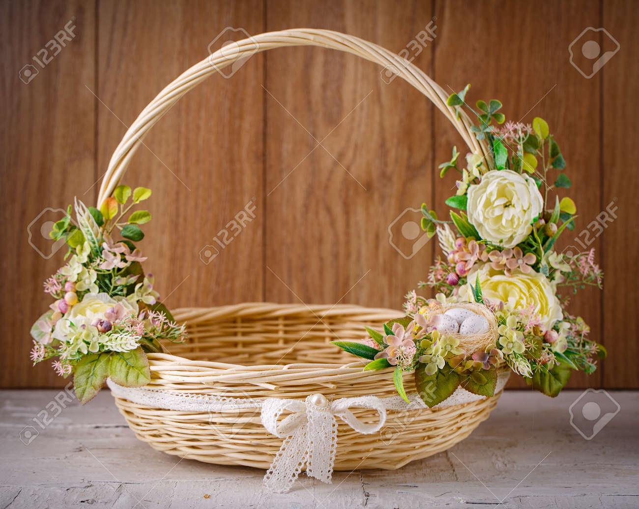 Designer basket is decorated with flowers. Wicker basket for..