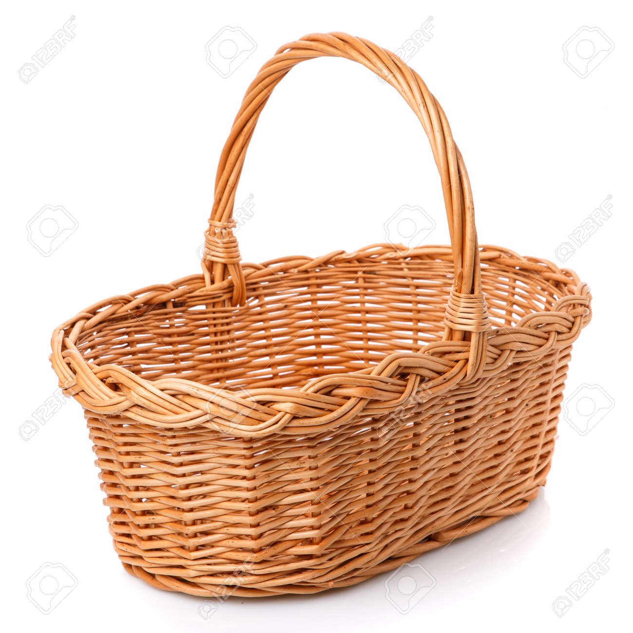 Big square brown wicker basket made of vines on a white background. - 145640113