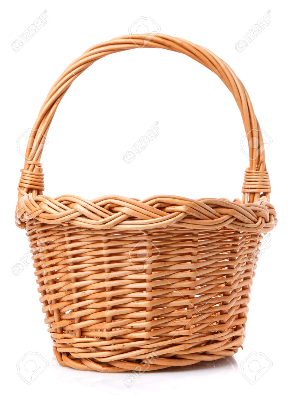 Big wicker basket on a white background. The basket is made of vines. - 149831236