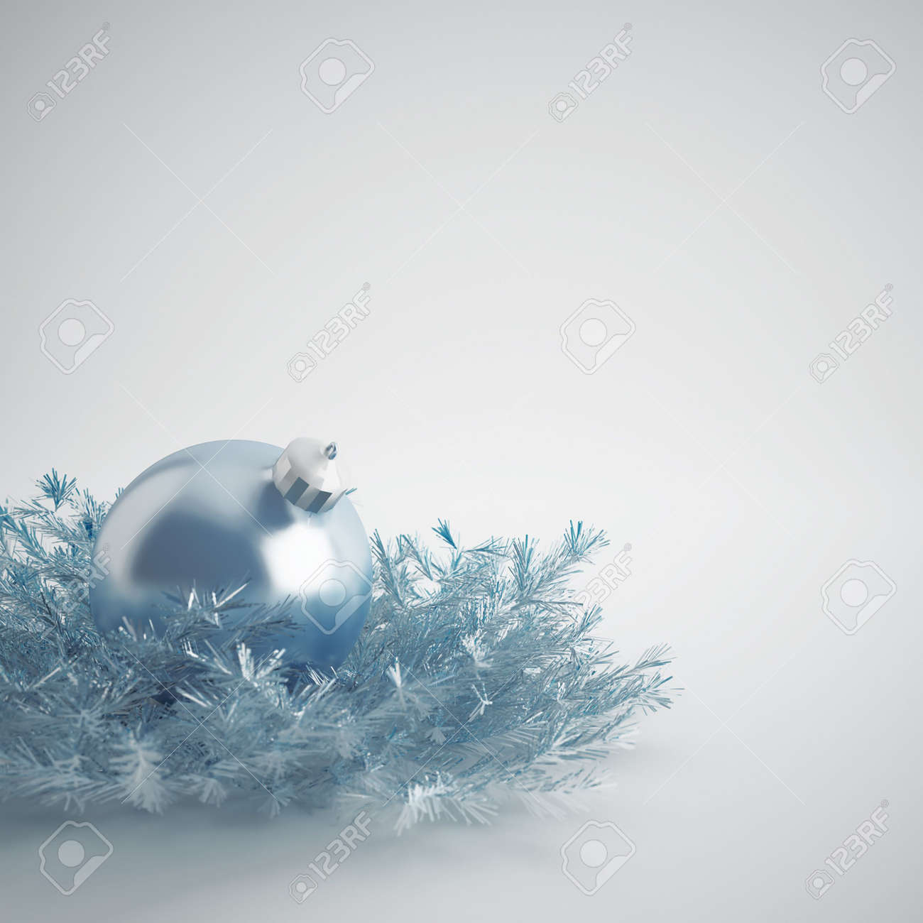 Christmas ball of gentle blue color in an environment of a tinsels and decorations Stock Photo - 5729116