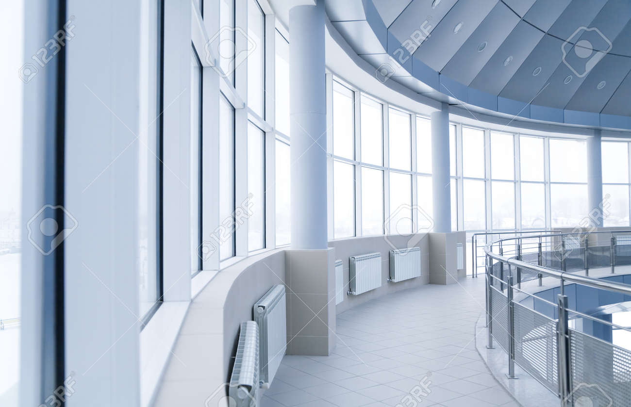 modern interior office stock. windows and columns in the rounded interior of modern office building stock c