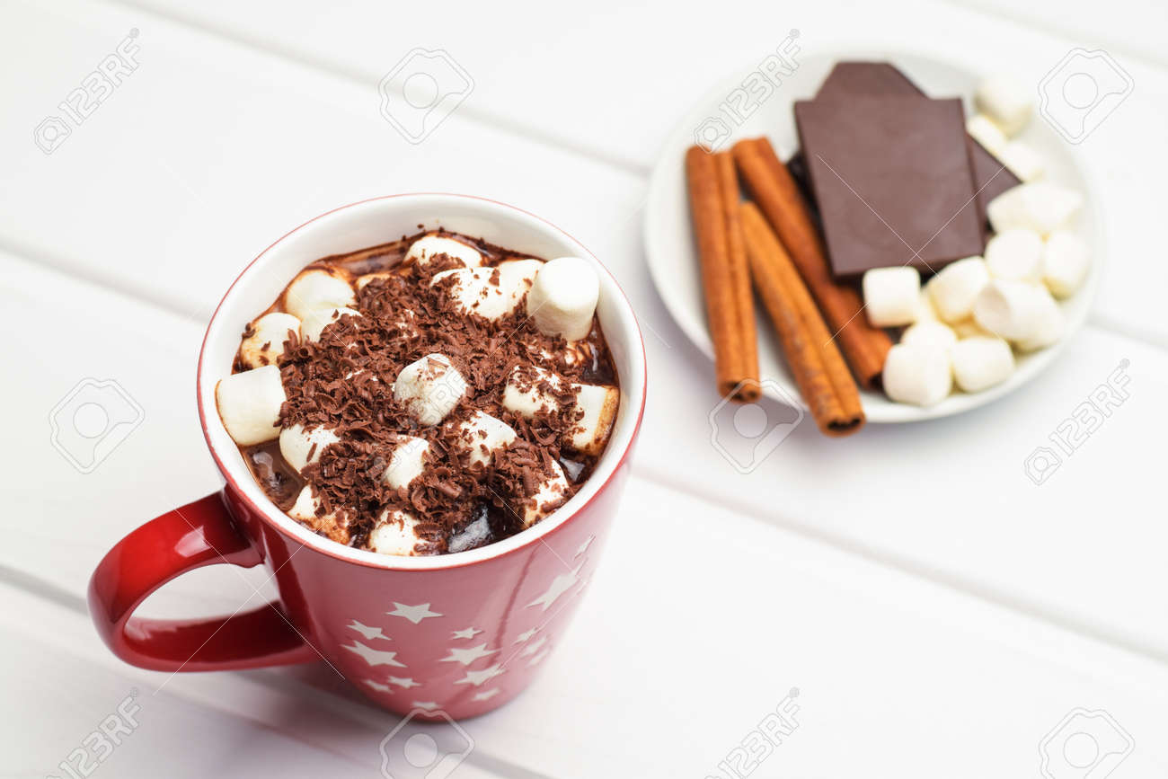 Cocoa in a red mug and ingredients. - 113828153
