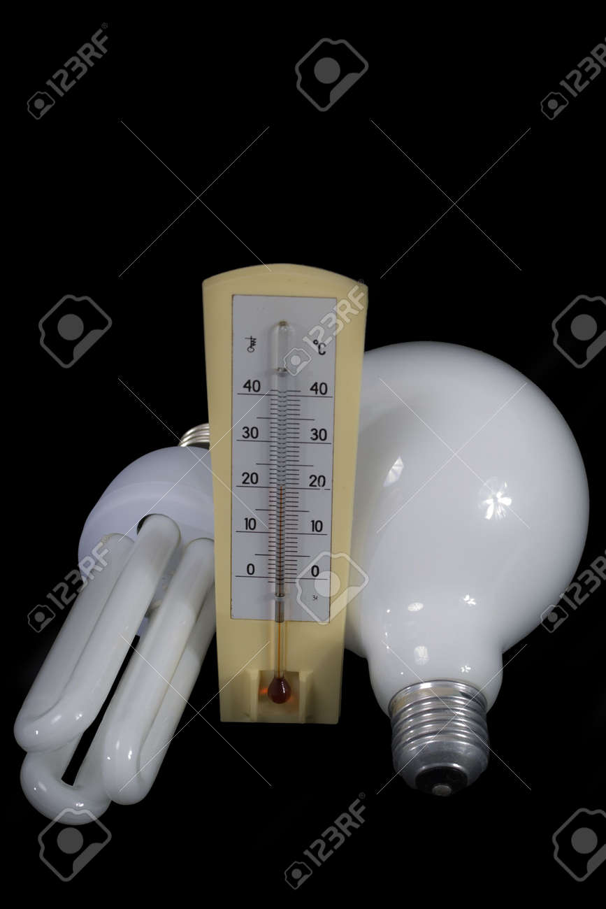 Energy efficient and traditional bulb with thermometr on black background Stock Photo - 4229852