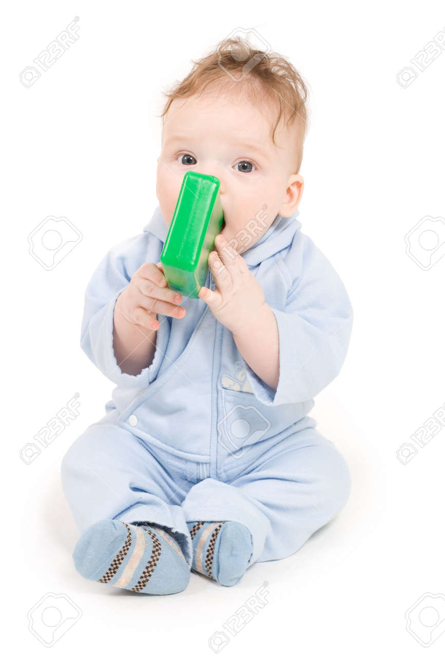 Baby playing with green plastic block sitting on the floor Stock Photo - 4609069