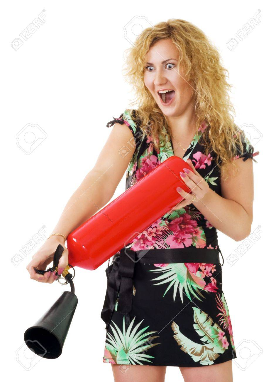 blond woman extinguish fire using fire extinguisher Stock Photo - 5060508