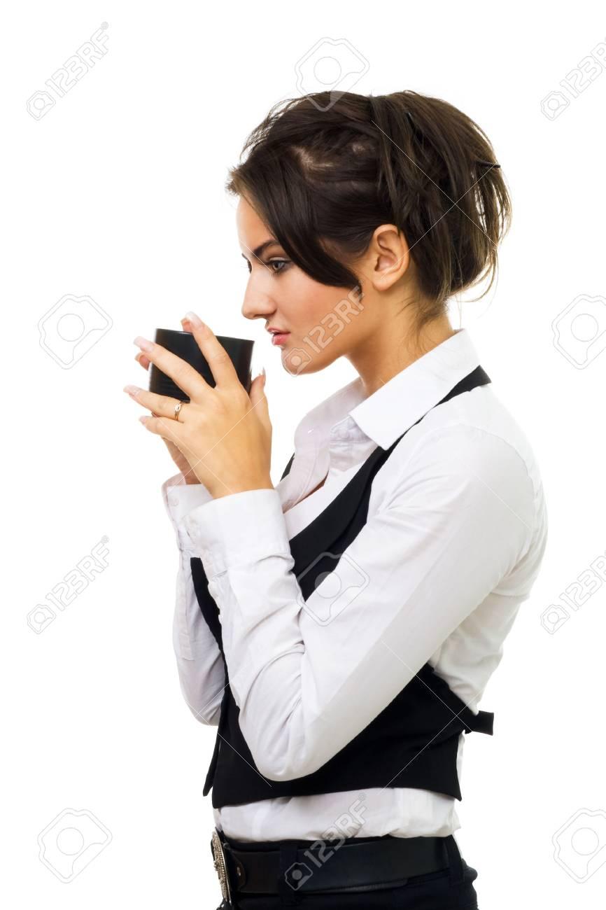 Foto de archivo - Mujer en traje de gala bebida de café de pie en el perfil  de taza de negro aislado en blanco c0c9d644183a