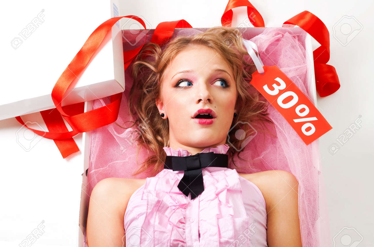 Doll in present box, shocked at the sale price on white background Stock Photo - 6121671
