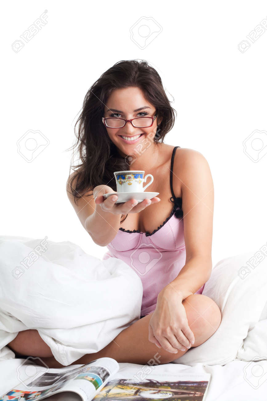 Woman smile and give cup of coffee sitting in bed Stock Photo - 6445071