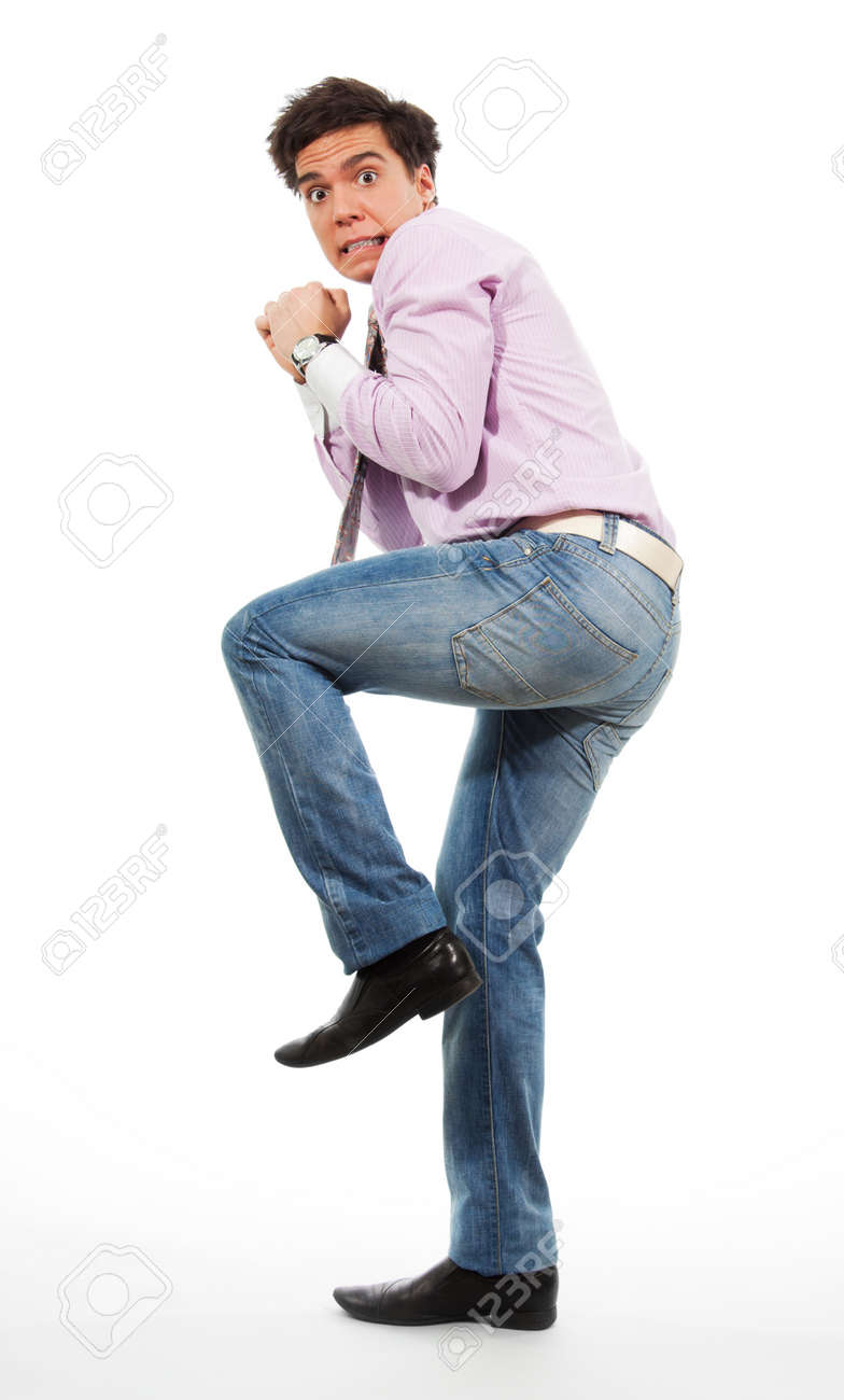 Scared man running away with grimace in his face wearing jeans, shirt and tie Stock Photo - 9096879