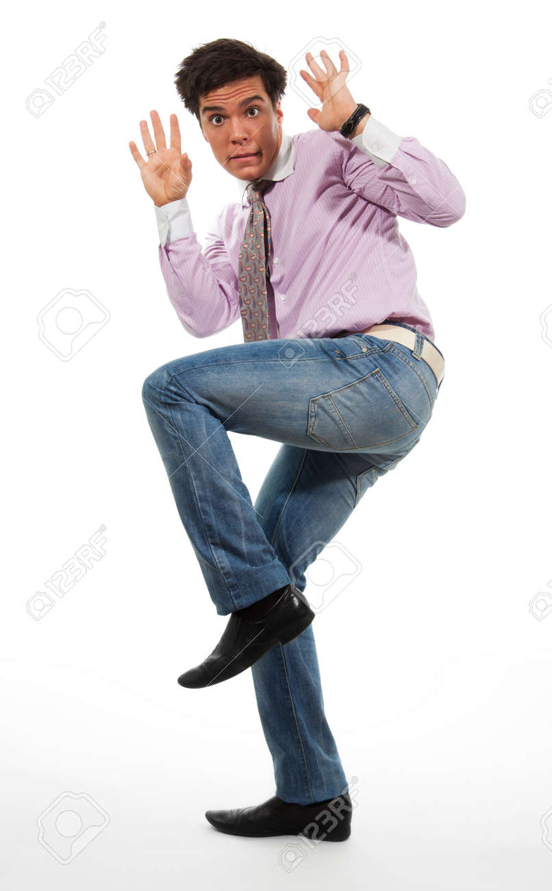 terrified man surrender wearing jeans, shirt and tie, isolated on white Stock Photo - 9096894