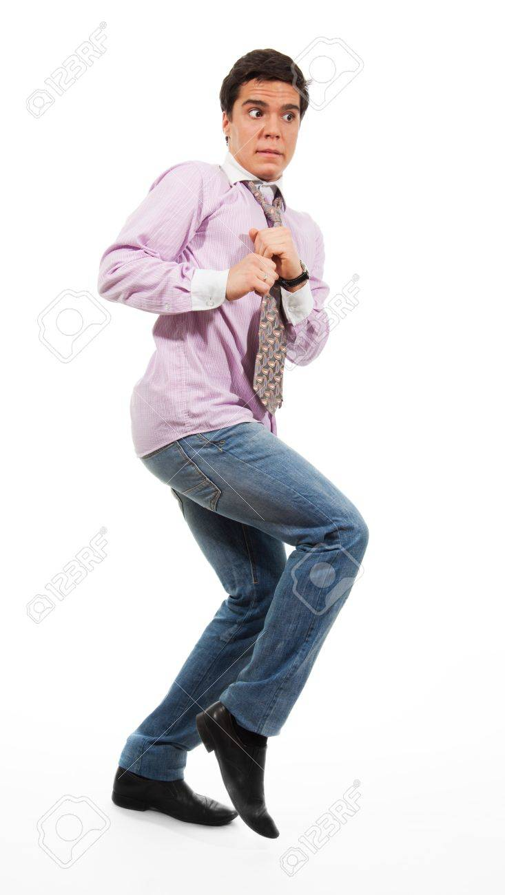 A man slinking with afraid face expression, wearing jeans, shirt and tie, isolated on white Stock Photo - 9097021