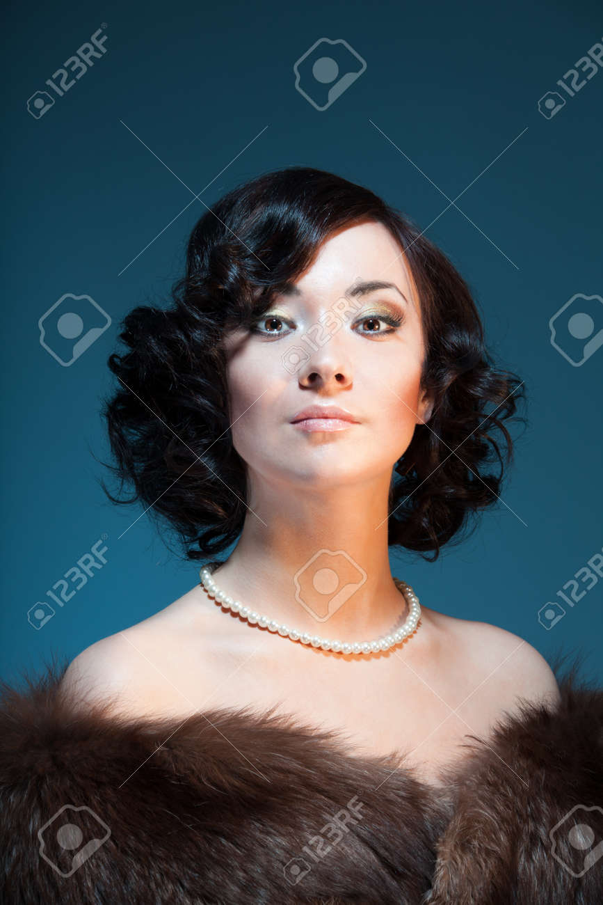 Retro style color portrait of a woman with stylish hairstyle and fashionable clothes Stock Photo - 9101067