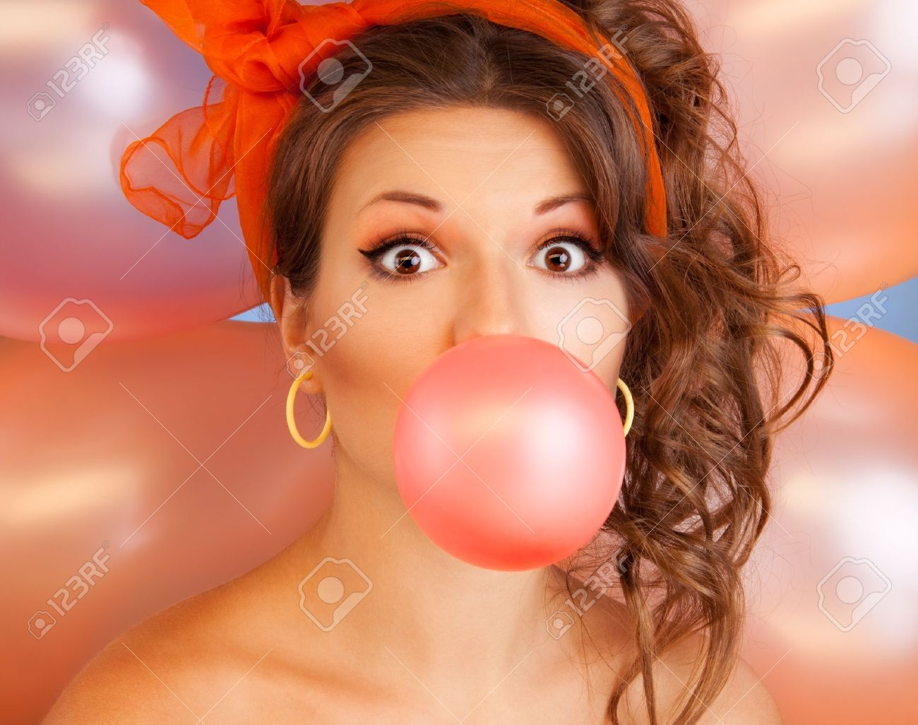 Happy woman at party blowing bubblegum bubble with air baloons on background Stock Photo - 9486768