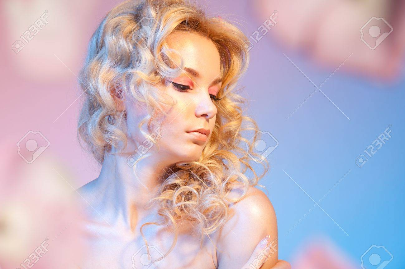 Shy beautiful bloody woman with curly hair and naked shoulders Stock Photo - 9487036