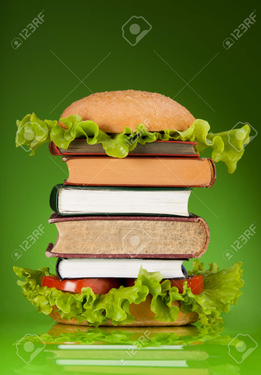 Knowledge fast food concept represented by burger with books on green background Stock Photo - 10142775