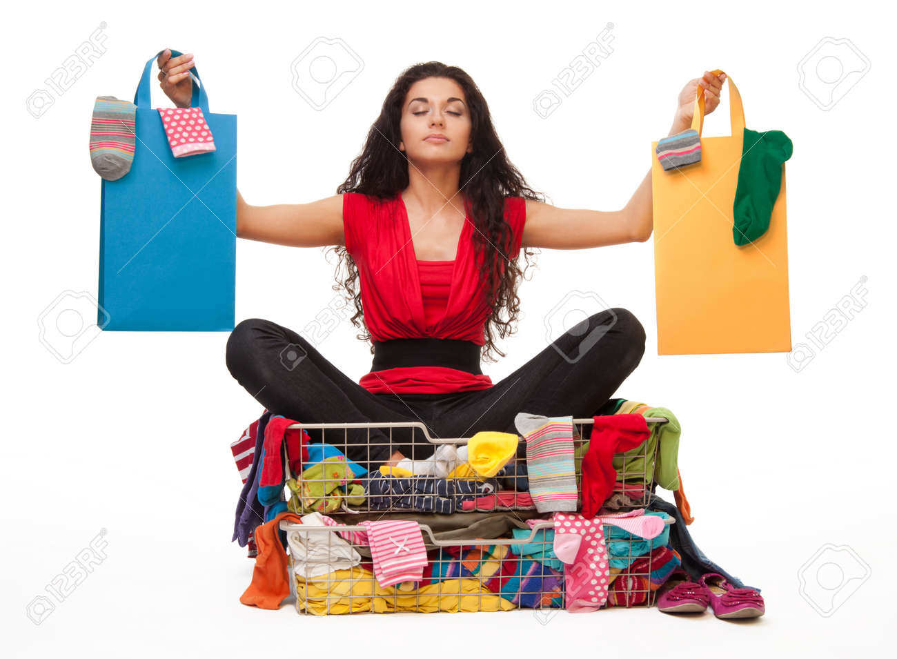 Woman Holding Shopping Bags And Sitting In Clothes Basket With ...