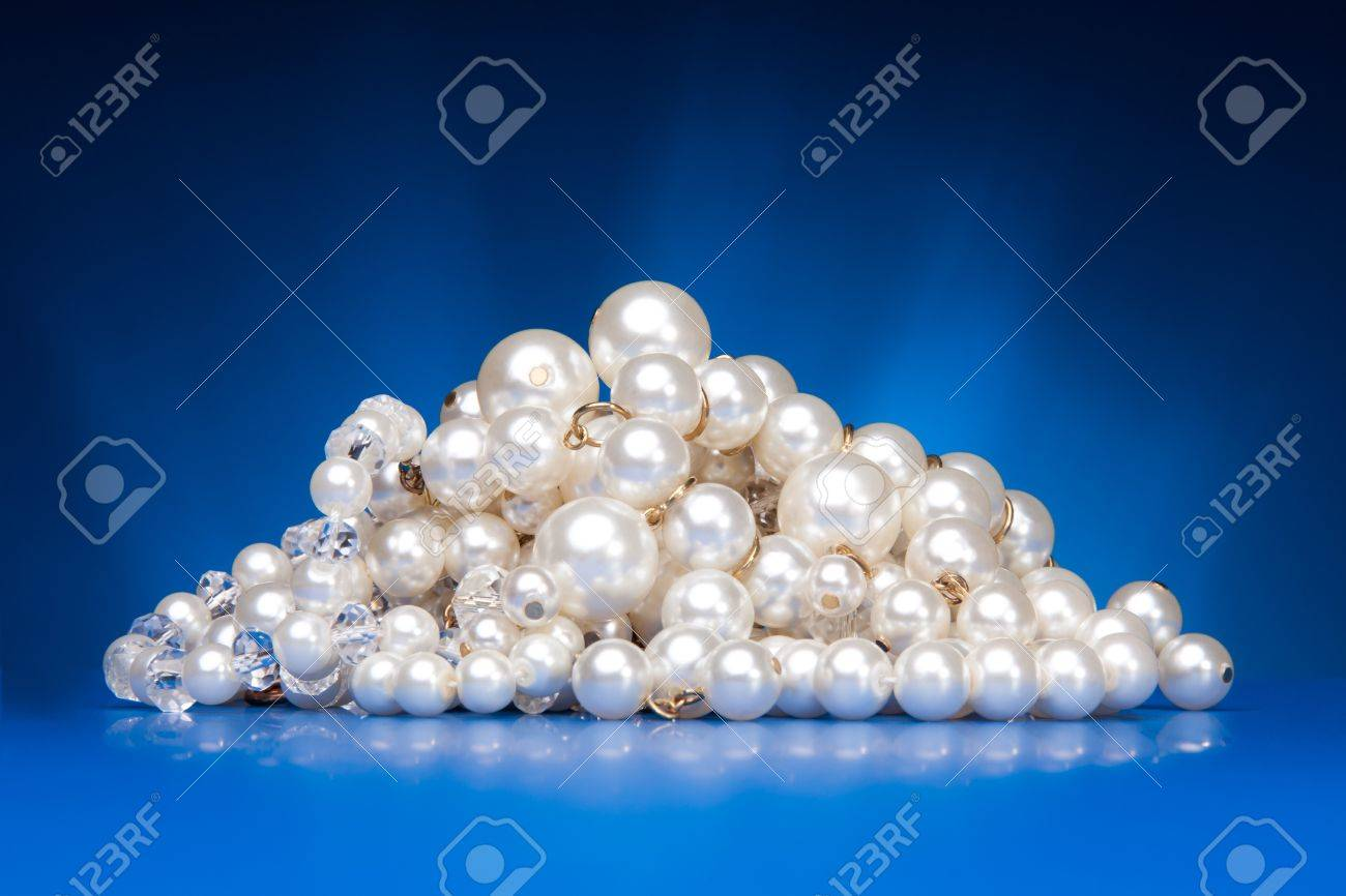 Shining  pearls necklace on blue background Stock Photo - 11753498