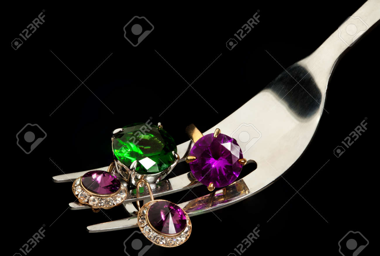 Macro shoot of fork with jewelry Stock Photo - 11749578