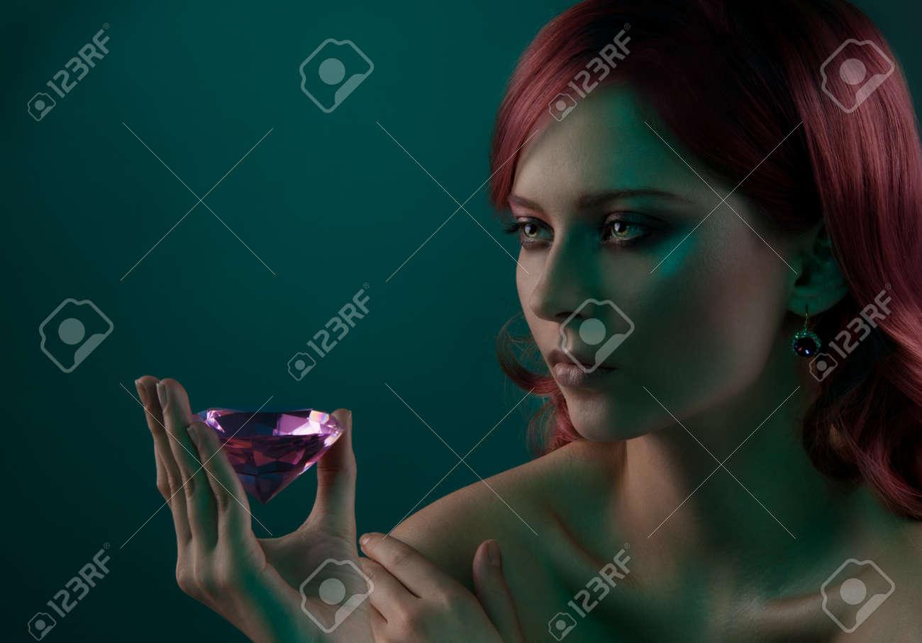 Beauty portrait of woman with big pink diamond Stock Photo - 11753533