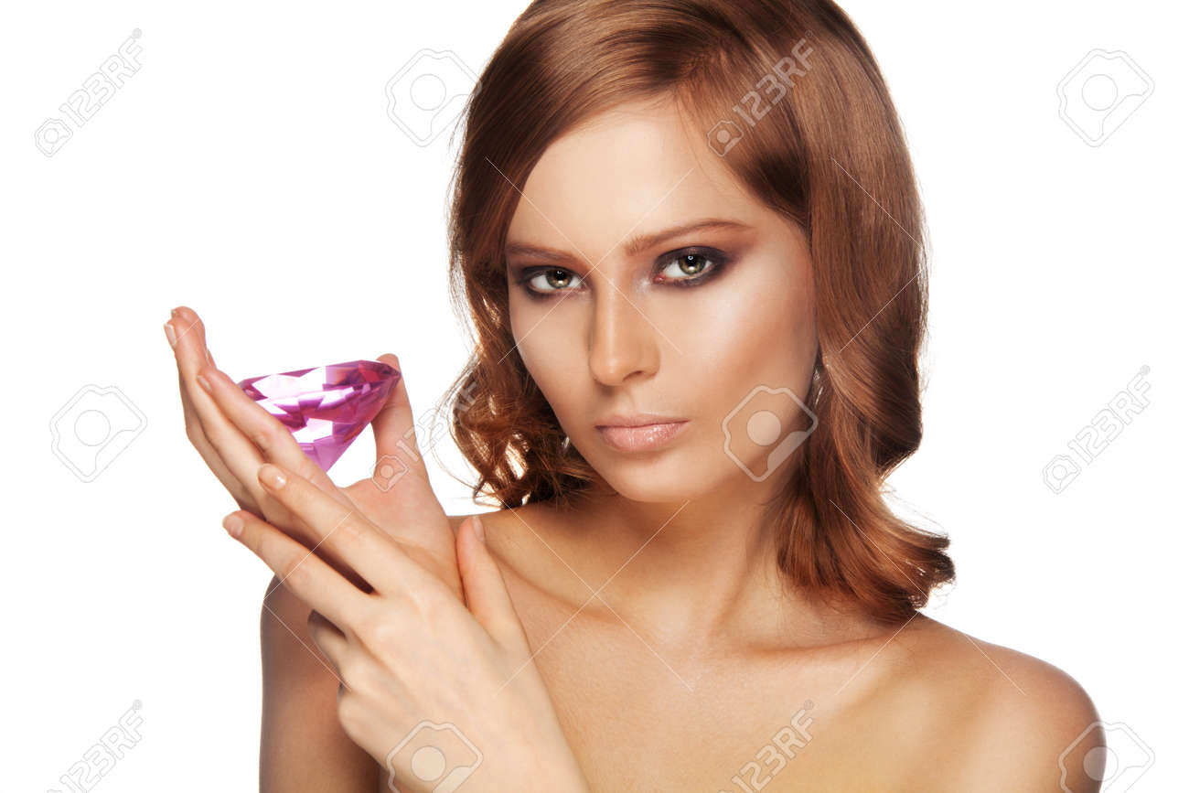 Beauty portrait of woman with big pink diamond on white background Stock Photo - 11753548