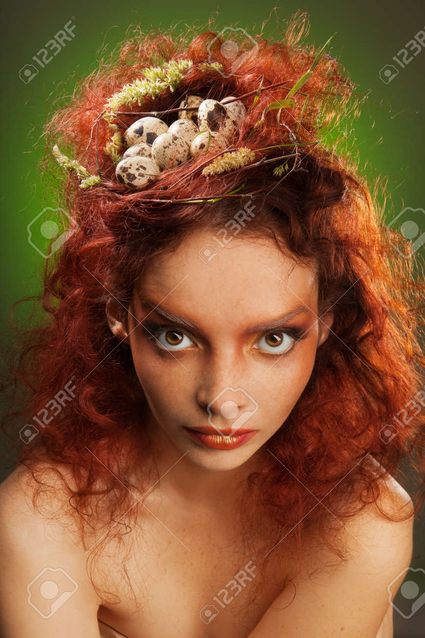 Beauty portrait of a woman with birds nest in curly red hairs Stock Photo - 11753956
