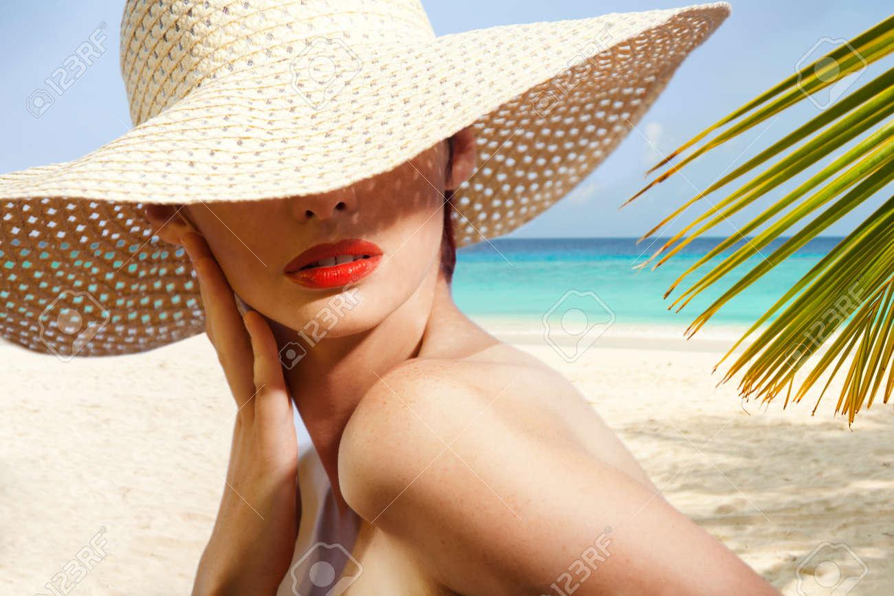 Beauty portrait of woman on the beach wearing straw hat Stock Photo - 11753716