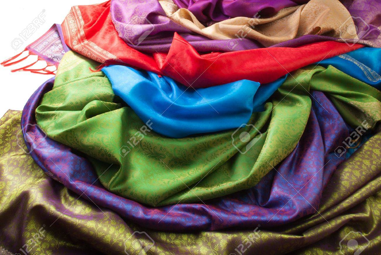 pile of beautiful fabrics of different color and texture stock