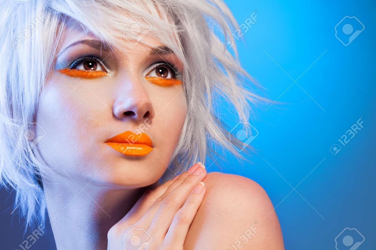 sexy blond woman portrait on blue background Stock Photo - 15861401