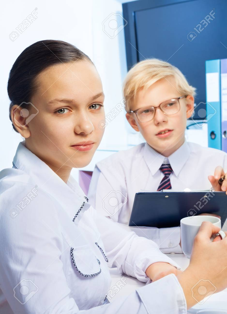 12 years old girl with her friends playing to be boss and his personal assistant Stock Photo - 17420400