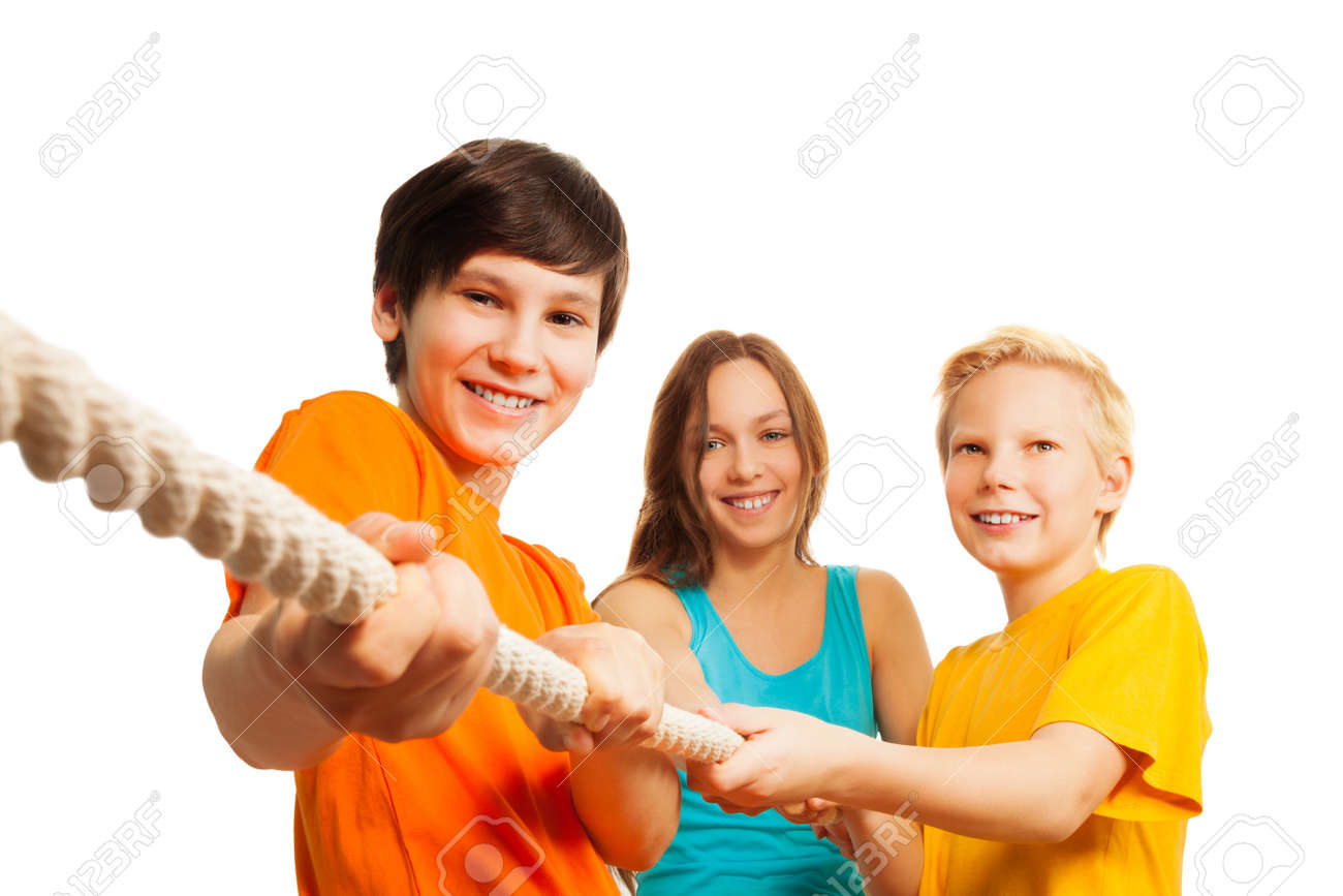 Three teen friends pulling the rope, trying to win competition Stock Photo - 17420422