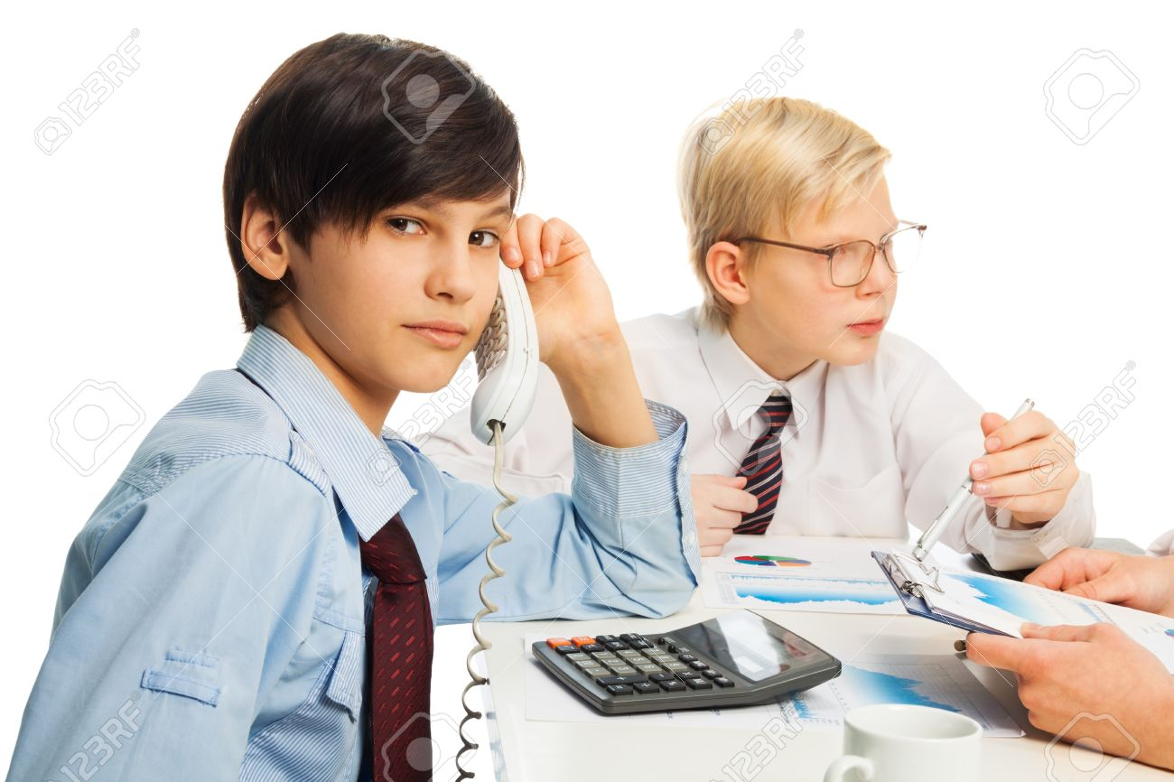 stock photo two kids pretending to be adult sitting in office and doing job chores