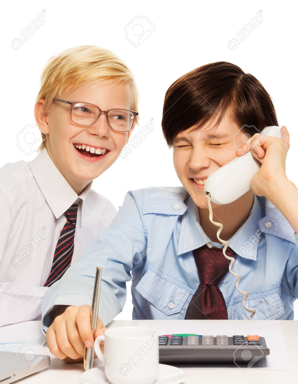 Two kids playing adult businessmen joking and laughing on the phone Stock Photo - 17540830