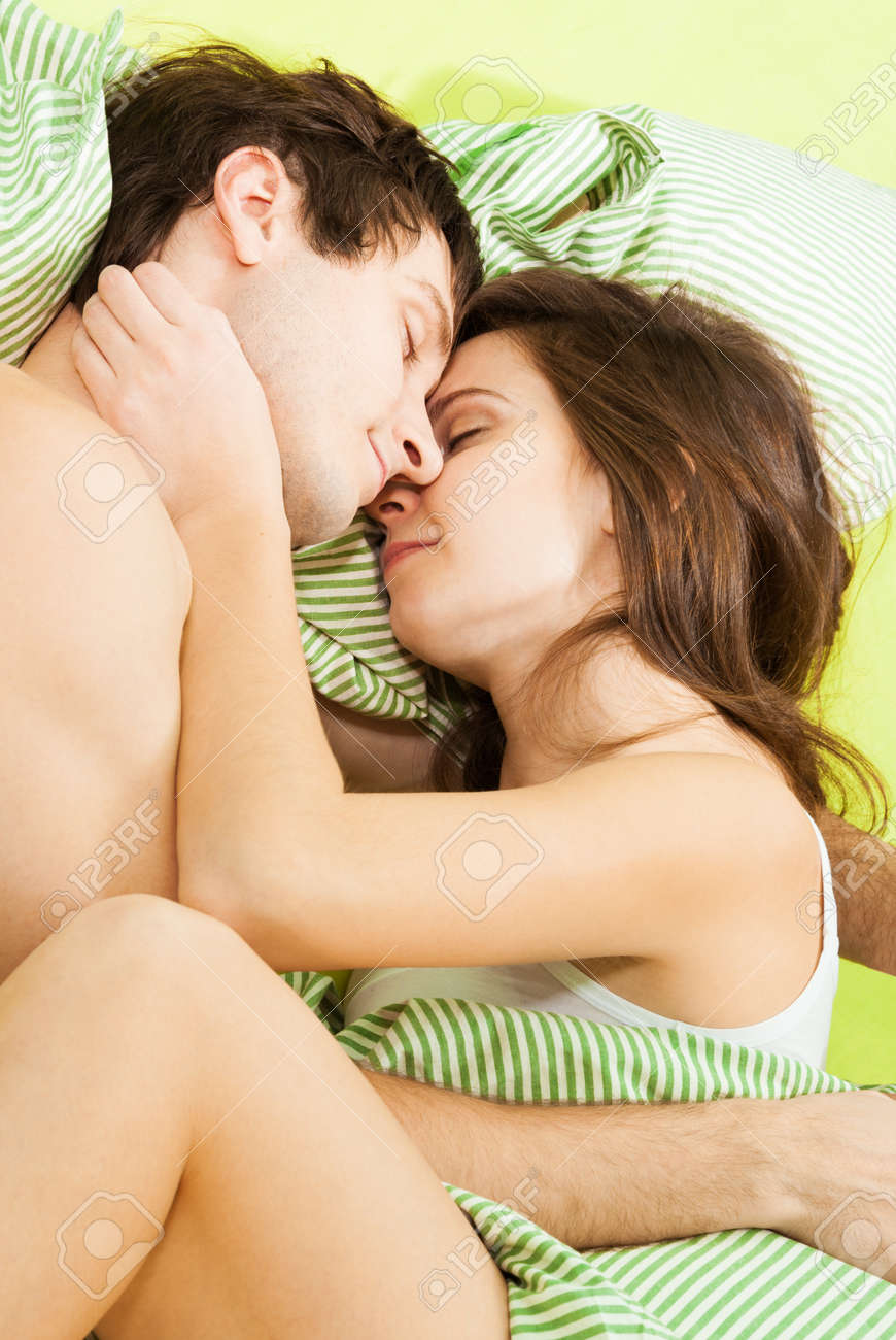 Couple sleeping together in bed with smile on their faces Stock Photo - 17420755