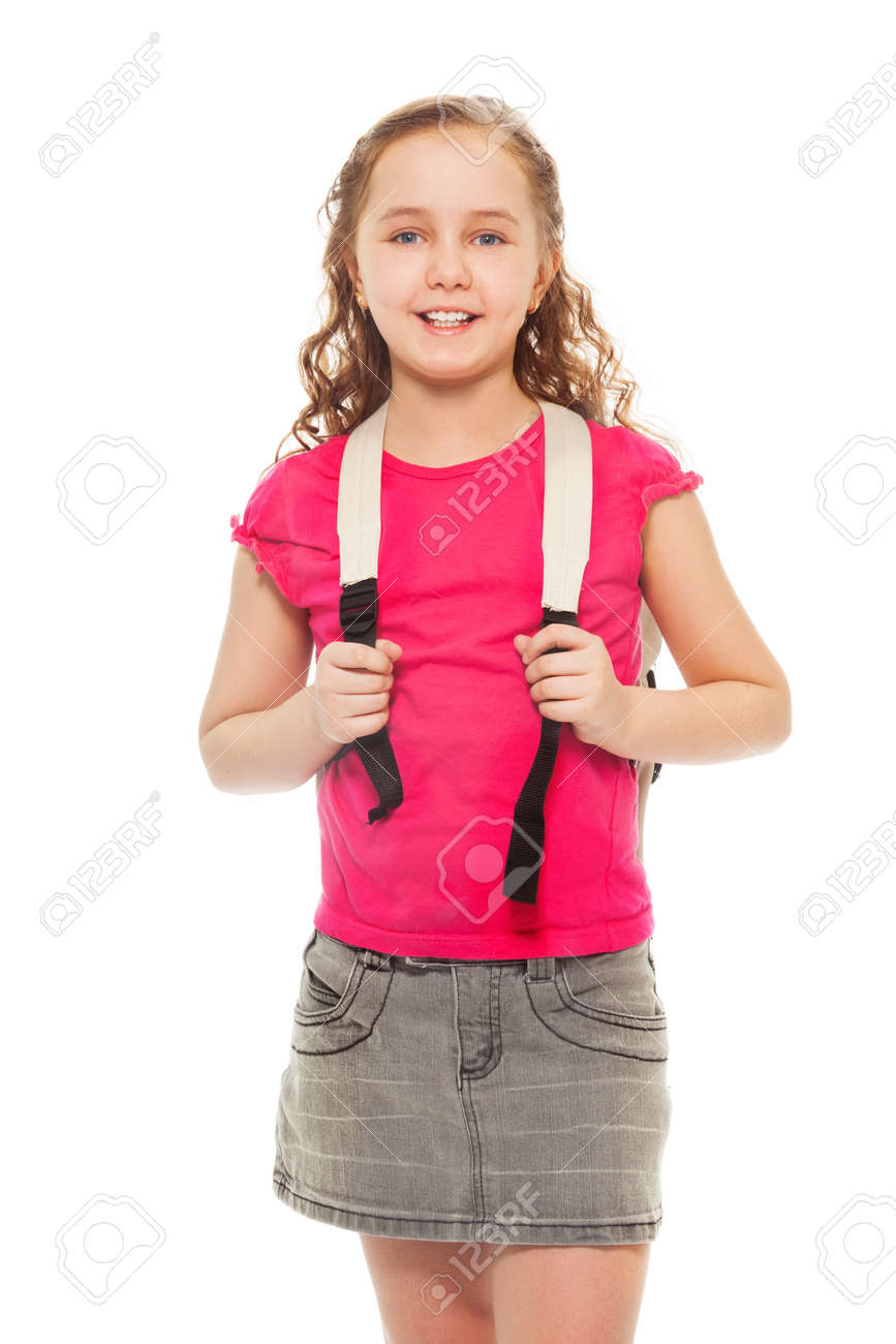 Portrait of happy, smiling and laughing, confident 9 years old girl with curly hair, wearing backpack isolated on white - full height portrait Stock Photo - 18255653