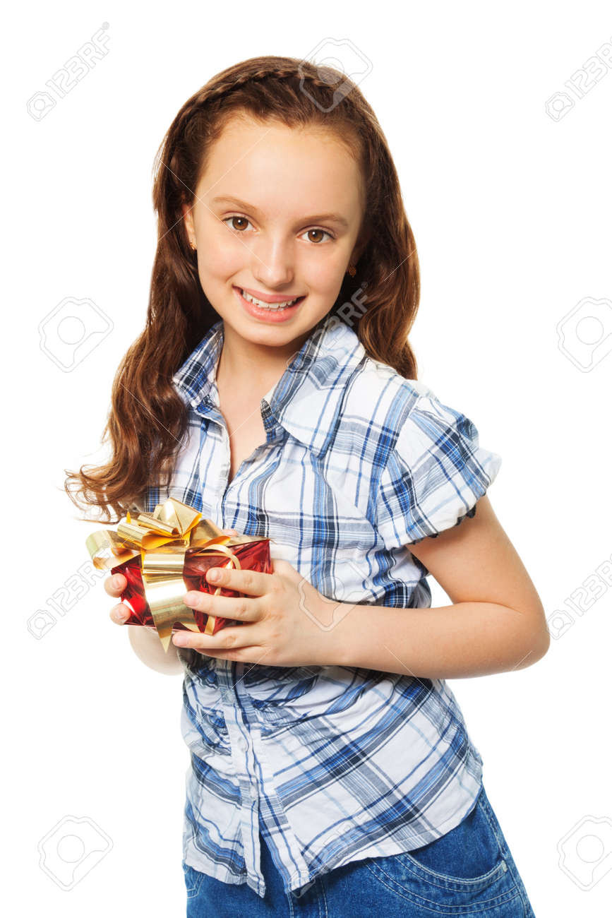 Happy teen Caucasian girl holding small red present box with gold bow with  smile on her