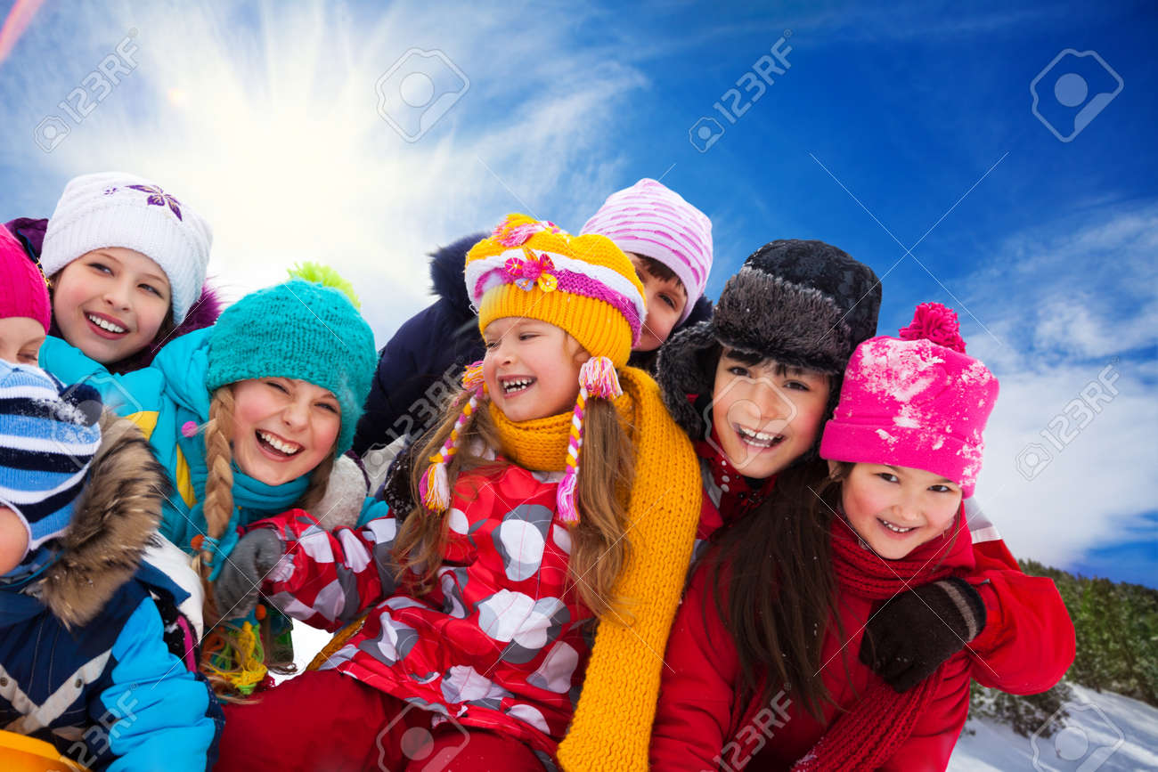 Group Of Diversity Looking Happy Kids Together On Winter Sunny ...