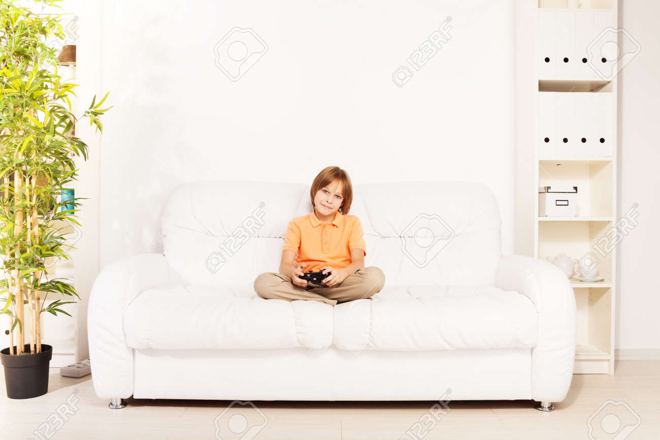 Happy Smiling Caucasian Boy Gamer Playing Video Games Holding ...